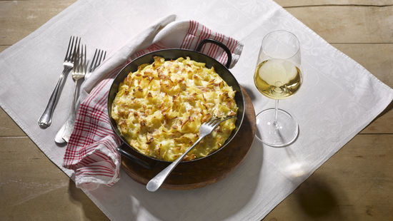Pasta Ham Bake with a glass of white wine