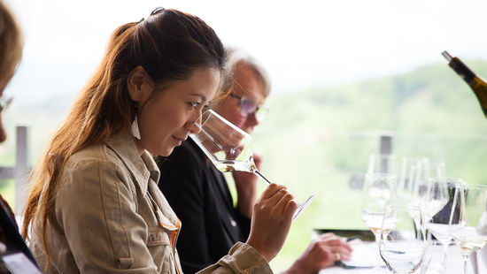 This image shows a woman during a wine tasting