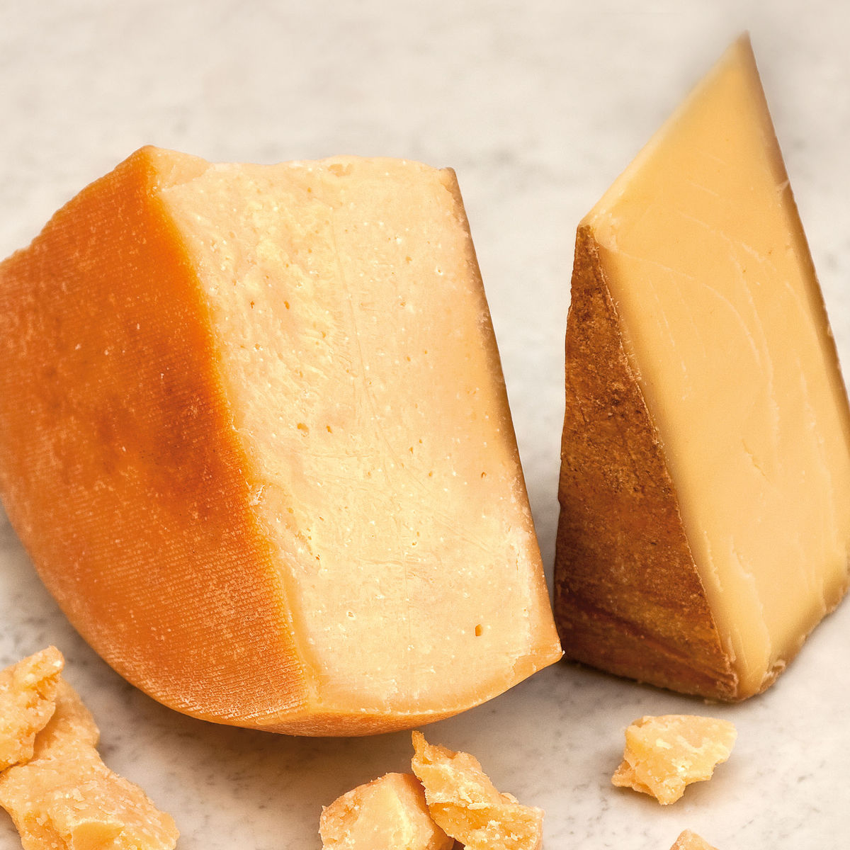The picture shows several kinds of hard cheese.